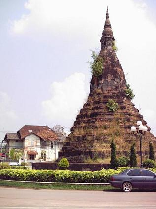 An ancient chedi with a house